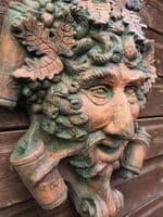 Bacchus face decorative stone wall plaque Mascaron